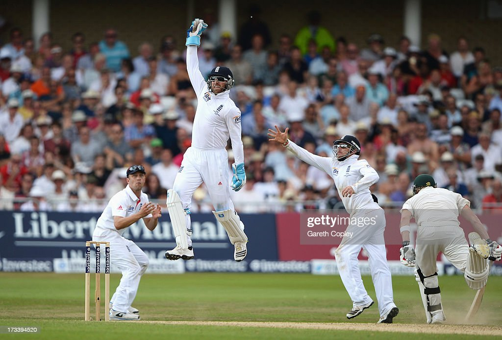Wicketkeeper <a gi-track='captionPersonalityLinkClicked' href=/galleries/search?phrase=Matt+Prior+-+Cricket+Player&family=editorial&specificpeople=13652111 ng-click='$event.stopPropagation()'>Matt Prior</a> of England jumps for the ball watched by <a gi-track='captionPersonalityLinkClicked' href=/galleries/search?phrase=Jonathan+Trott&family=editorial&specificpeople=654505 ng-click='$event.stopPropagation()'>Jonathan Trott</a> (L) and <a gi-track='captionPersonalityLinkClicked' href=/galleries/search?phrase=Ian+Bell&family=editorial&specificpeople=206128 ng-click='$event.stopPropagation()'>Ian Bell</a> during day four of the 1st Investec Ashes Test match between England and Australia at Trent Bridge Cricket Ground on July 13, 2013 in Nottingham, England.