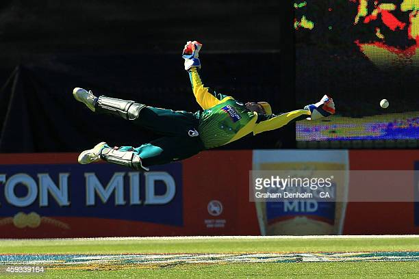 Wicketkeeper Matthew Wade attempts a catch during game four of the One Day International series between Australia and South Africa at Melbourne...
