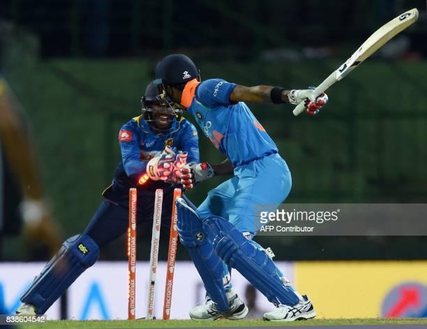 Wicketkeeper Niroshan Dickwella stumps Indias' Hardik Pandya to dismiss him during the second One Day International cricket match between Sri Lanka...
