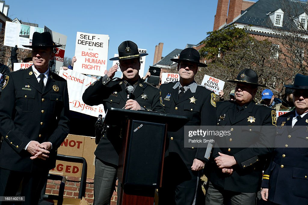 Wicomico County Sheriff Michael A. Lewis and other Maryland sheriffs speak as they and other Second Amendment supporters rally against stricter gun control laws at the Maryland State House on March 5, 2013 in Annapolis, Maryland. If the Maryland Firearm Safety Act legislation bill is passed, it would require a license to purchase a handgun, ban the sale of assault style rifles and limit magazine size, among other provisions.