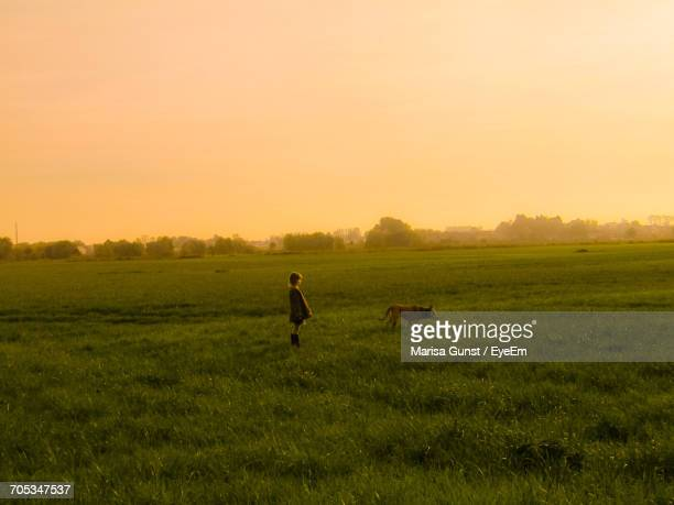 Wide Angle Of Landscape With Girl And Dog