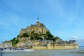 Wide angle seafloor level view of the fortified town of Mont St Michel in North France
