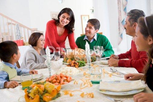Wide Angle Shot Of Family Christmas Formal Dinner Stock Photo