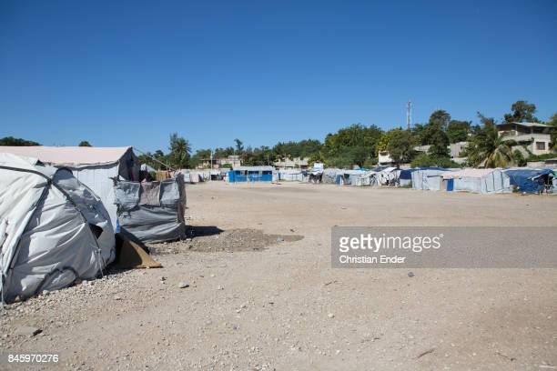 PortauPrince Haiti December 09 2012 Wide angle view at a sandy square between several tents in the refugee camp Parc Colofe in PortauPrince The camp...