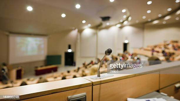 Wide angle view of a lecture hall, focus on microphone