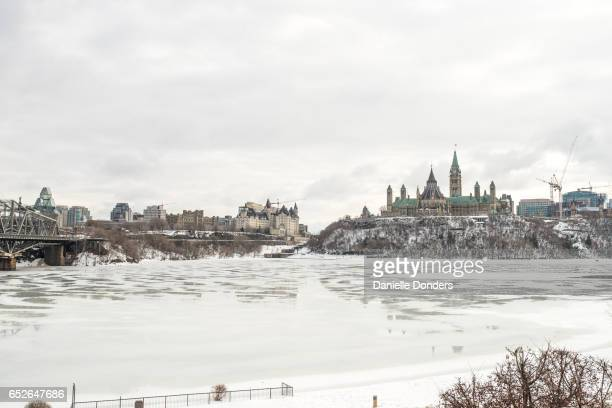Wide angle view of frozen Parliament Buildings and downtown Ottawa in winter