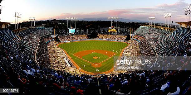 A wide angle view of the Los Angeles Dodgers Stadium as the Station fires burn in the distance on August 31 2009 in Los Angeles California