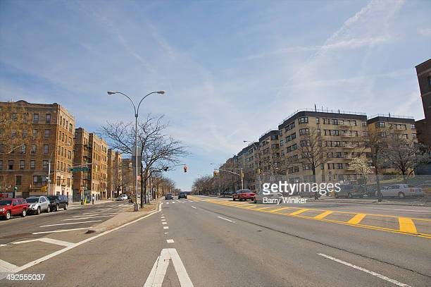 Wide boulevard lined with apartment buildings