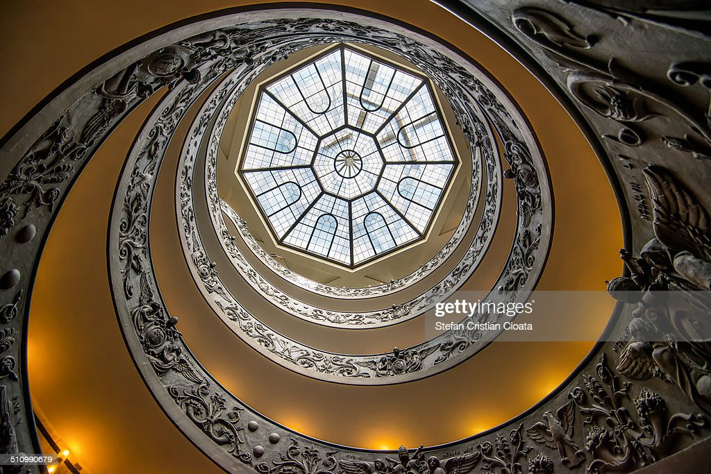 Wide image of Vatican Museum staircase viewed from down to ceiling