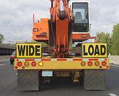 Truck carrying construction equipment