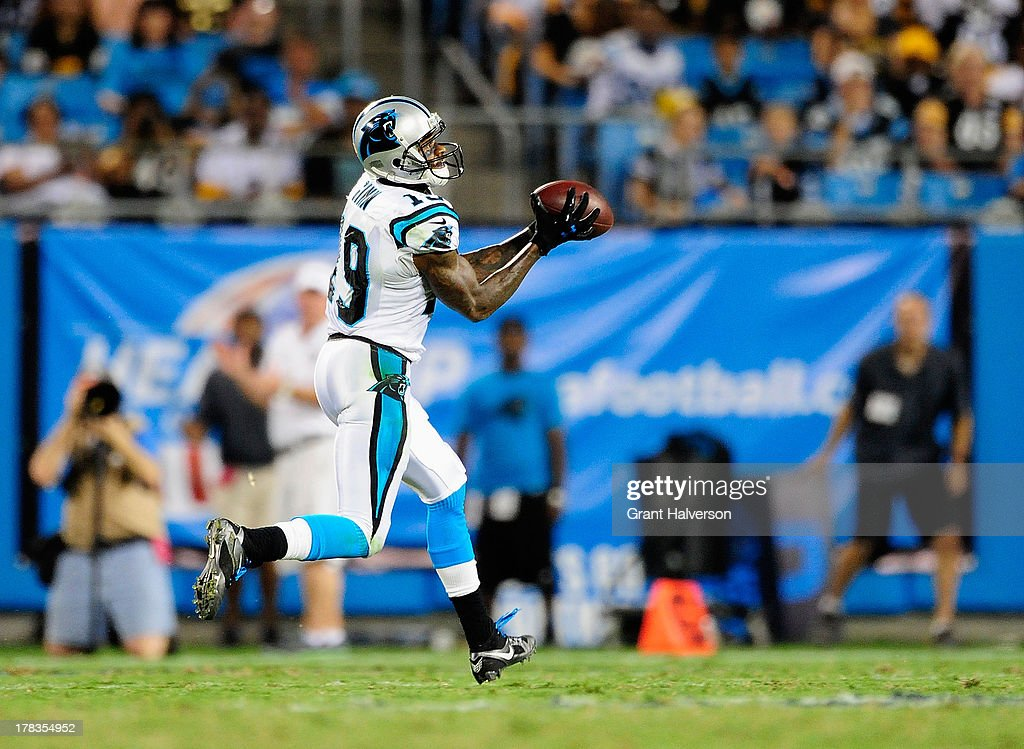 A wide open Ted Ginn Jr. #19 of the Carolina Panthers scores his second touchdown of the night against the Pittsburgh Steelers during a preseason NFL game at Bank of America Stadium on August 29, 2013 in Charlotte, North Carolina.