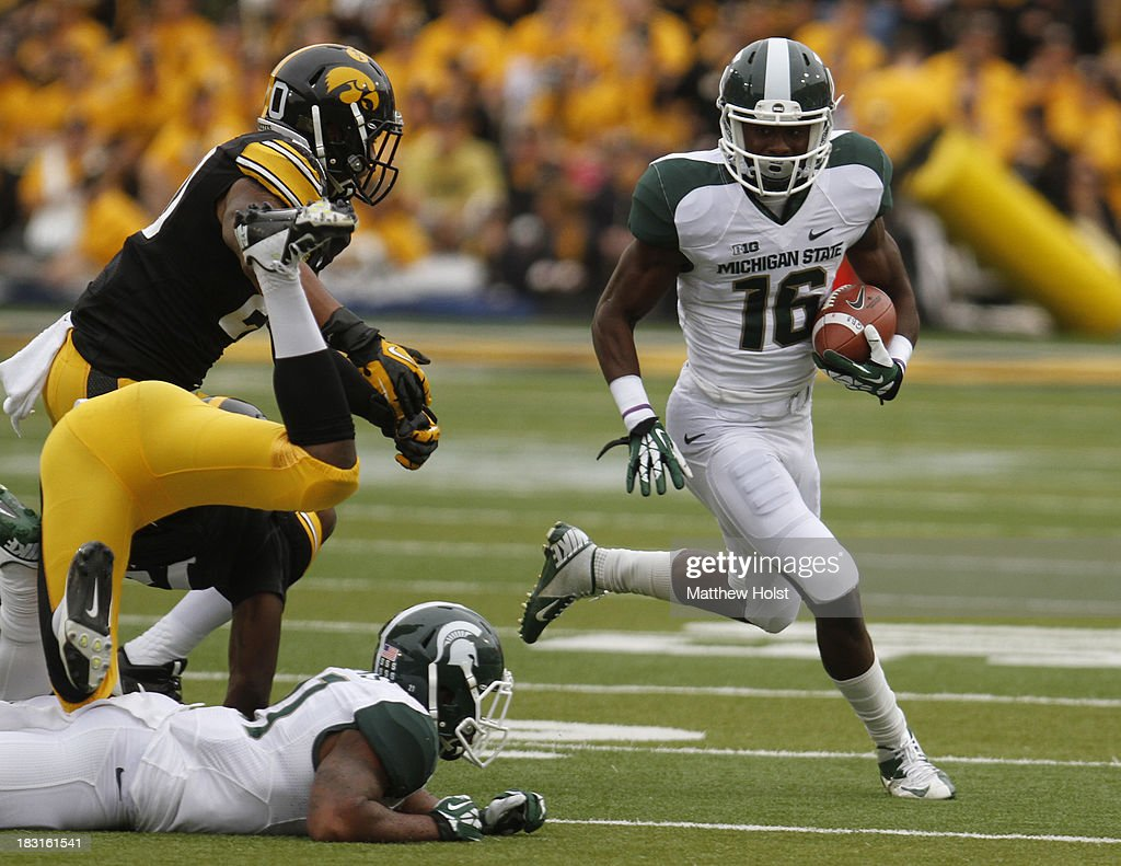 Wide receiver Aaron Burbridge #16 of the Michigan State Spartans rushes up field during the first quarter in front of linebacker Christian Kirksey #20 of the Iowa Hawkeyes on October 5, 2013 at Kinnick Stadium in Iowa City, Iowa.