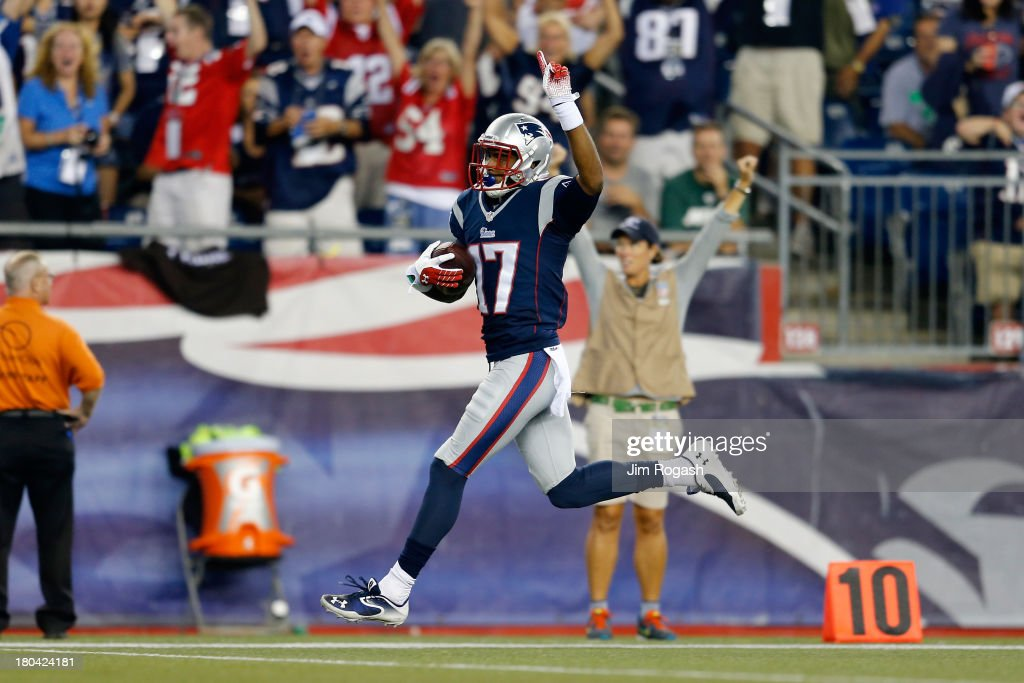 Wide receiver <a gi-track='captionPersonalityLinkClicked' href=/galleries/search?phrase=Aaron+Dobson&family=editorial&specificpeople=6336020 ng-click='$event.stopPropagation()'>Aaron Dobson</a> #17 of the New England Patriots celebrates as he runs to score on a 39-yard catch in the first quarter against the New York Jets at Gillette Stadium on September 12, 2013 in Foxboro, Massachusetts.