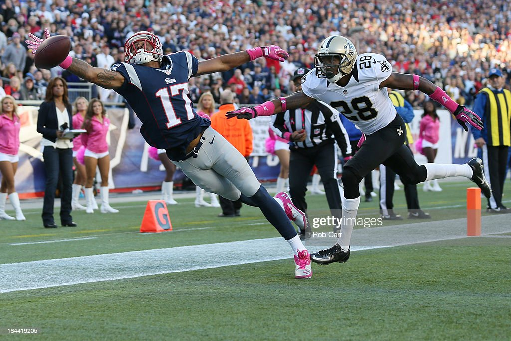Wide receiver <a gi-track='captionPersonalityLinkClicked' href=/galleries/search?phrase=Aaron+Dobson&family=editorial&specificpeople=6336020 ng-click='$event.stopPropagation()'>Aaron Dobson</a> #17 of the New England Patriots misses a pass while being defended by cornerback <a gi-track='captionPersonalityLinkClicked' href=/galleries/search?phrase=Keenan+Lewis&family=editorial&specificpeople=2167460 ng-click='$event.stopPropagation()'>Keenan Lewis</a> #28 of the New Orleans Saints during the first half at Gillette Stadium on October 13, 2013 in Foxboro, Massachusetts.