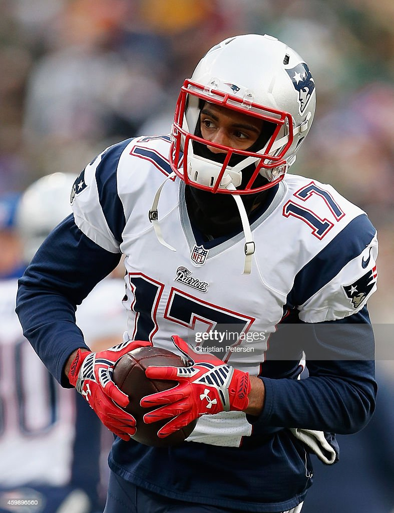 Wide receiver <a gi-track='captionPersonalityLinkClicked' href=/galleries/search?phrase=Aaron+Dobson&family=editorial&specificpeople=6336020 ng-click='$event.stopPropagation()'>Aaron Dobson</a> #17 of the New England Patriots warms up before the NFL game against the Green Bay Packers at Lambeau Field on November 30, 2014 in Green Bay, Wisconsin. The Packers defeated the Patriots 26-21.