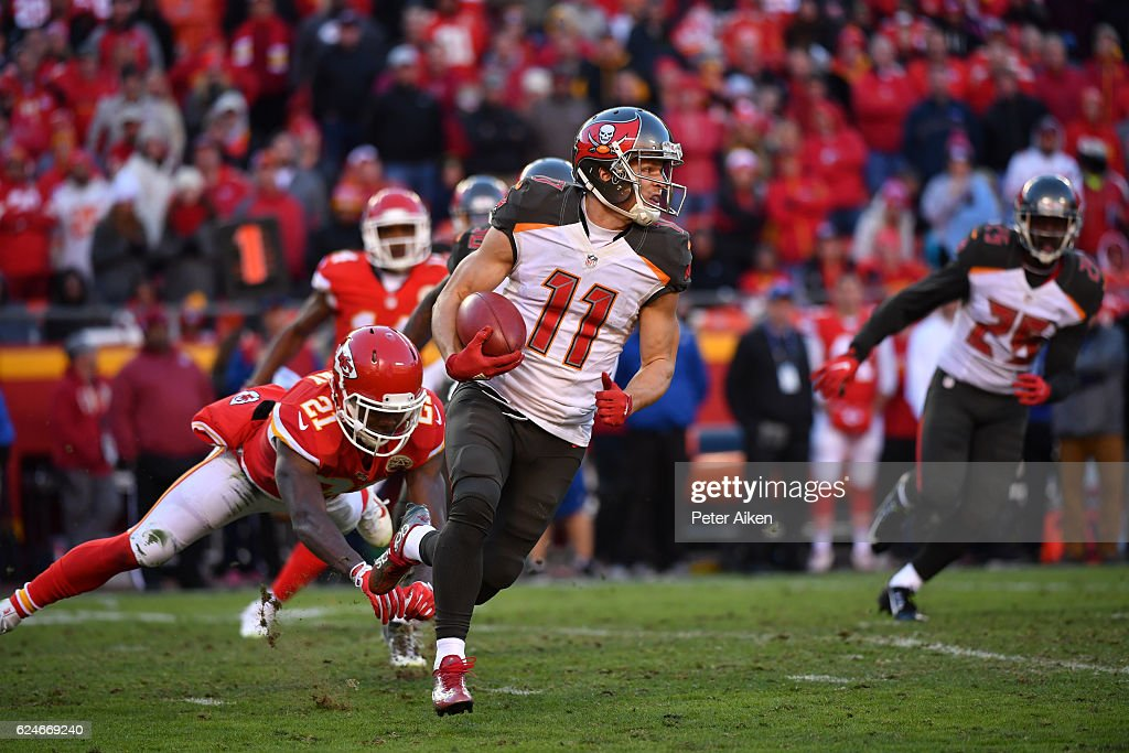 Wide receiver Adam Humphries #11 of the Tampa Bay Buccaneers runs beyond the tackle attempt of cornerback Eric Murray #21 of the Kansas City Chiefs at Arrowhead Stadium during the fourth quarter of the game on November 20, 2016 in Kansas City, Missouri.