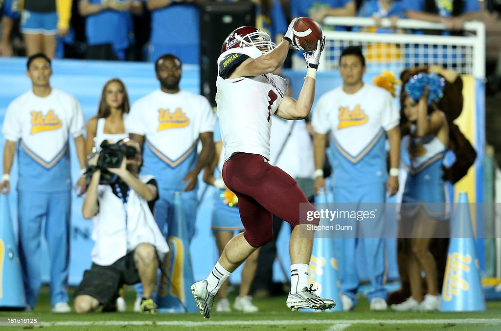 Wide receiver Adam Shapiro #7 of the New Mexico State Aggies catches a 33 yard touchdown pass in the fourth quarter against the UCLA Bruins at the Rose Bowl on September 21, 2013 in Pasadena, California. UCLA won 59-13.
