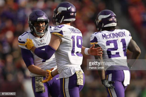 Wide receiver Adam Thielen of the Minnesota Vikings celebrates with quarterback Case Keenum of the Minnesota Vikings after scoring a touchdown during...