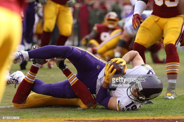Wide receiver Adam Thielen of the Minnesota Vikings makes a touchdown catch during the second quarter against the Washington Redskins at FedExField...
