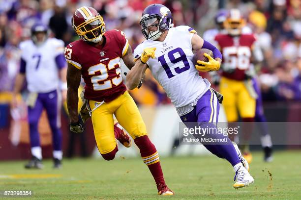 Wide receiver Adam Thielen of the Minnesota Vikings runs upfield against DeAngelo Hall of the Washington Redskins after a reception during the second...