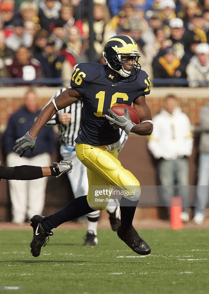 Wide receiver Adrian Arrington #16 of the Michigan Wolverines slips away from Trey Buice #8 of the Ball State Cardinals during the NCAA game against the Ball State Cardinals on November 4, 2006 at Michigan Stadium in Ann Arbor, Michigan. Michigan won 34-26.