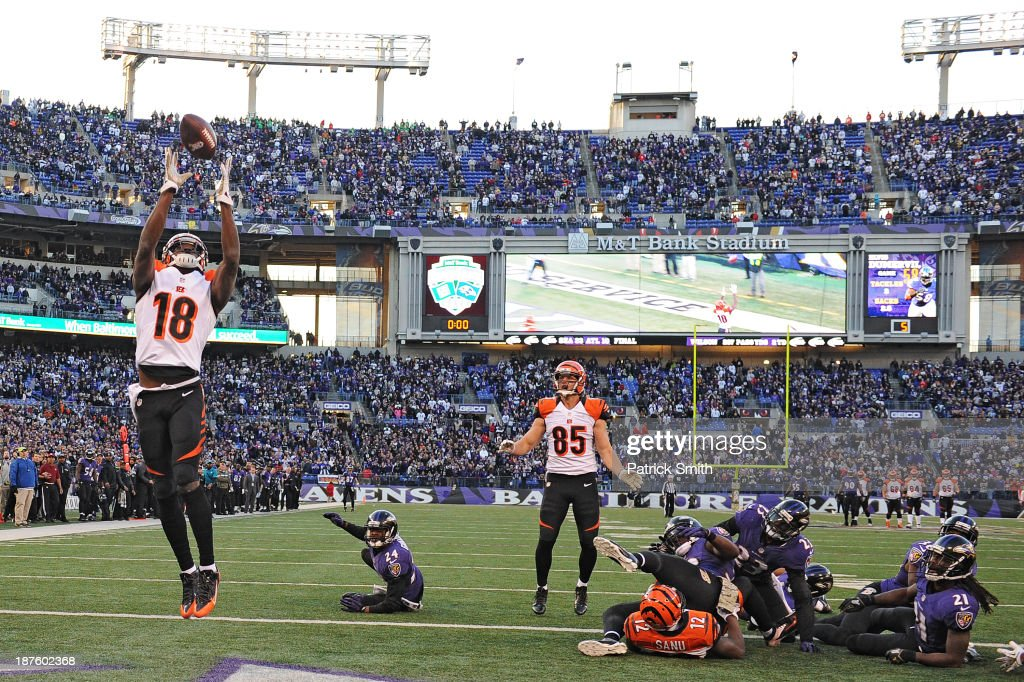 Wide receiver <a gi-track='captionPersonalityLinkClicked' href=/galleries/search?phrase=A.J.+Green&family=editorial&specificpeople=5525868 ng-click='$event.stopPropagation()'>A.J. Green</a> #18 of the Cincinnati Bengals catches a batted ball for a touchdown against the Baltimore Ravens in the fourth quarter at M&T Bank Stadium on November 10, 2013 in Baltimore, Maryland. The Baltimore Ravens won, 20-17, in overtime.