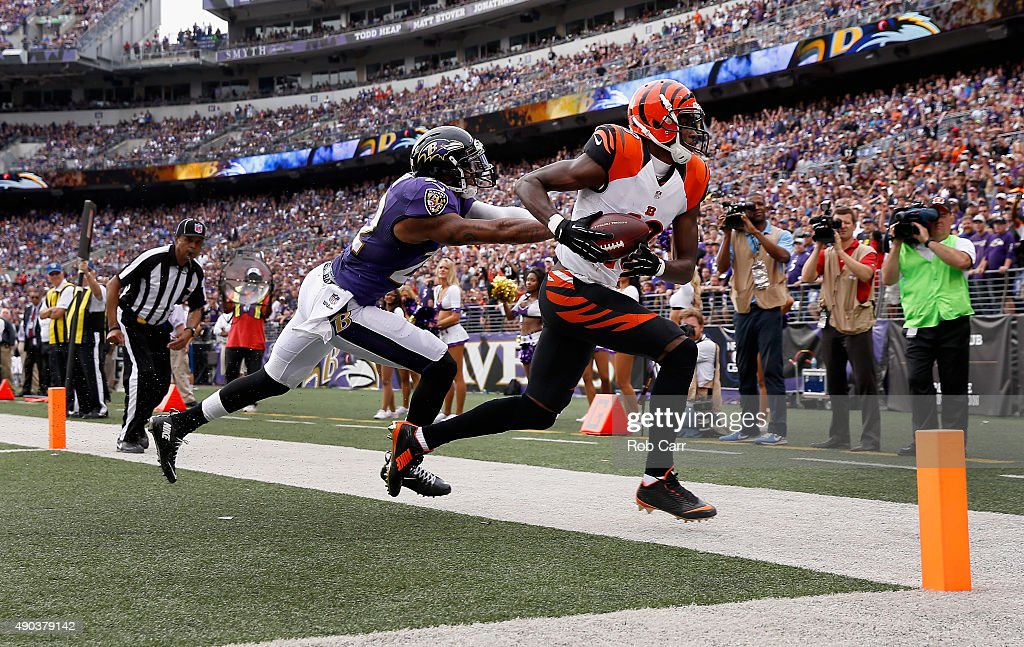 Wide receiver AJ Green of the Cincinnati Bengals catches a fourth quarter touchdown pass in front of cornerback Jimmy Smith of the Baltimore Ravens...