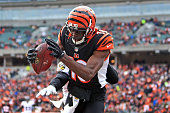 Wide receiver AJ Green of the Cincinnati Bengals catches a pass for a touchdown while being defended by defensive back Shareece Wright of the...
