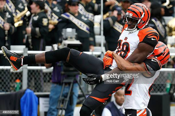 Wide receiver AJ Green of the Cincinnati Bengals celebrates a fourth quarter touchdown with wide receiver Marvin Jones of the Cincinnati Bengals...