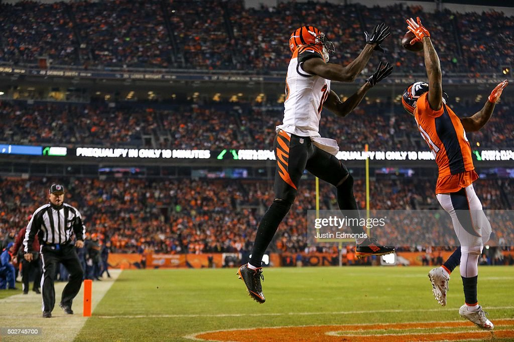 Wide receiver A.J. Green #18 of the Cincinnati Bengals makes a 5-yard touchdown reception under coverage by cornerback Aqib Talib #21 of the Denver Broncos in the first quarter of a game at Sports Authority Field at Mile High on December 28, 2015 in Denver, Colorado.