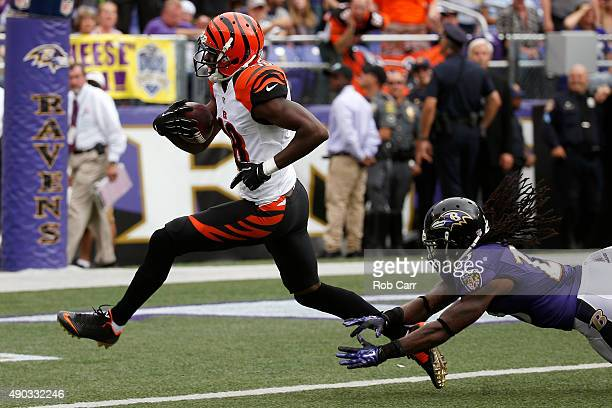 Wide receiver AJ Green of the Cincinnati Bengals scores a fourth quarter touchdown past free safety Kendrick Lewis of the Baltimore Ravens during a...