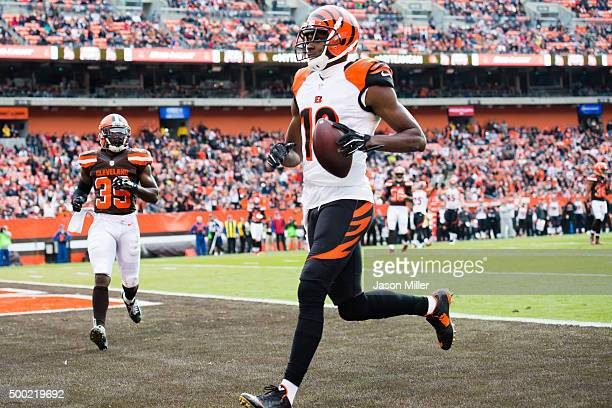 Wide receiver AJ Green of the Cincinnati Bengals scores a touchdown during the first half against the Cleveland Browns at FirstEnergy Stadium on...