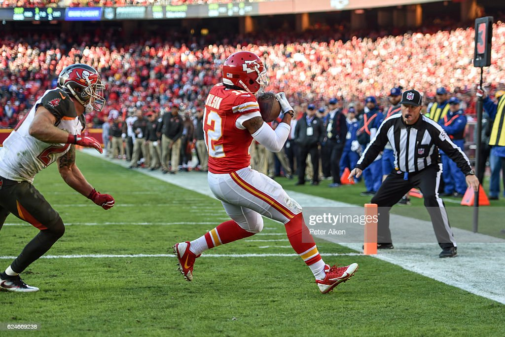 Wide receiver Albert Wilson #12 of the Kansas City Chiefs catches a touchdown pass in front of strong safety Chris Conte #23 of the Tampa Bay Buccaneers at Arrowhead Stadium during the fourth quarter of the game on November 20, 2016 in Kansas City, Missouri.