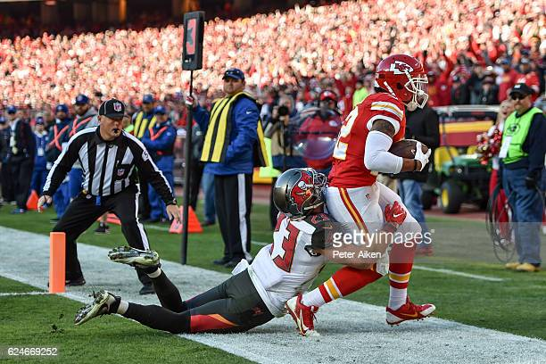 Wide receiver Albert Wilson of the Kansas City Chiefs catches a touchdown pass in front of strong safety Chris Conte of the Tampa Bay Buccaneers at...