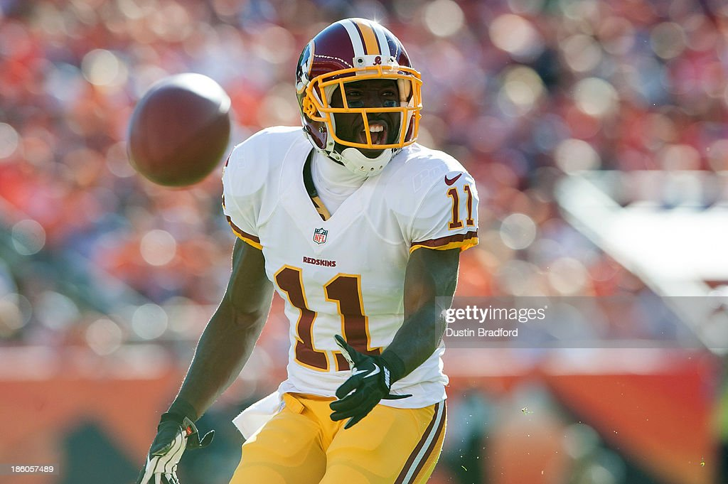 Wide receiver Aldrick Robinson #11 of the Washington Redskins reacts to pass interference and earns the call against the Denver Broncos at Sports Authority Field Field at Mile High on October 27, 2013 in Denver, Colorado.