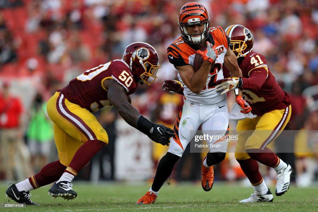 40a60718afd ... Wide receiver Alex Erickson 12 of the Cincinnati Bengals eludes  Washington Redskins defenders in the ...