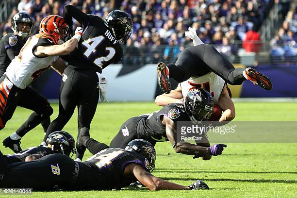 Wide receiver Alex Erickson of the Cincinnati Bengals is tackled by strong safety Matt Elam of the Baltimore Ravens in the first quarter at MT Bank...