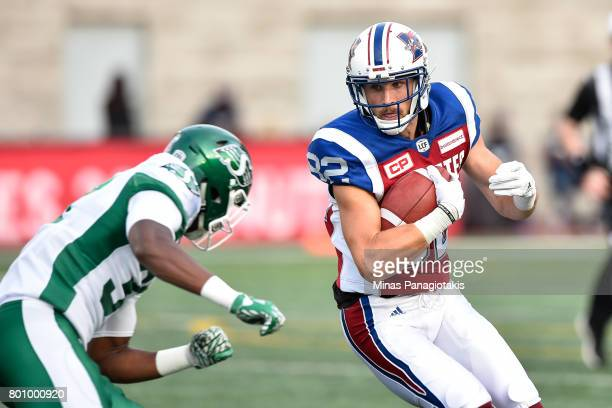 Wide receiver Alex Pierzchalski of the Montreal Alouettes protects the ball against the Saskatchewan Roughriders during the CFL game at Percival...