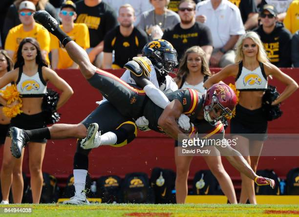 Wide receiver Allen Lazard of the Iowa State Cyclones pulls in a touchdown pass as defensive back Manny Rugamba of the Iowa Hawkeyes defends in the...