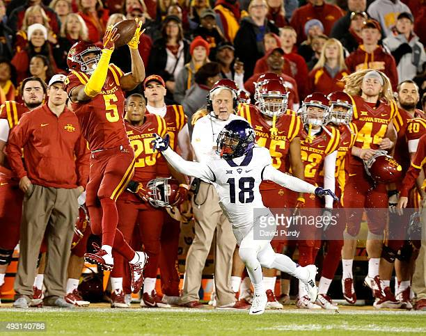 Wide receiver Allen Lazard of the Iowa State Cyclones pulls in a reception over safety Nick Orr of the TCU Horned Frogs in the first half of play at...