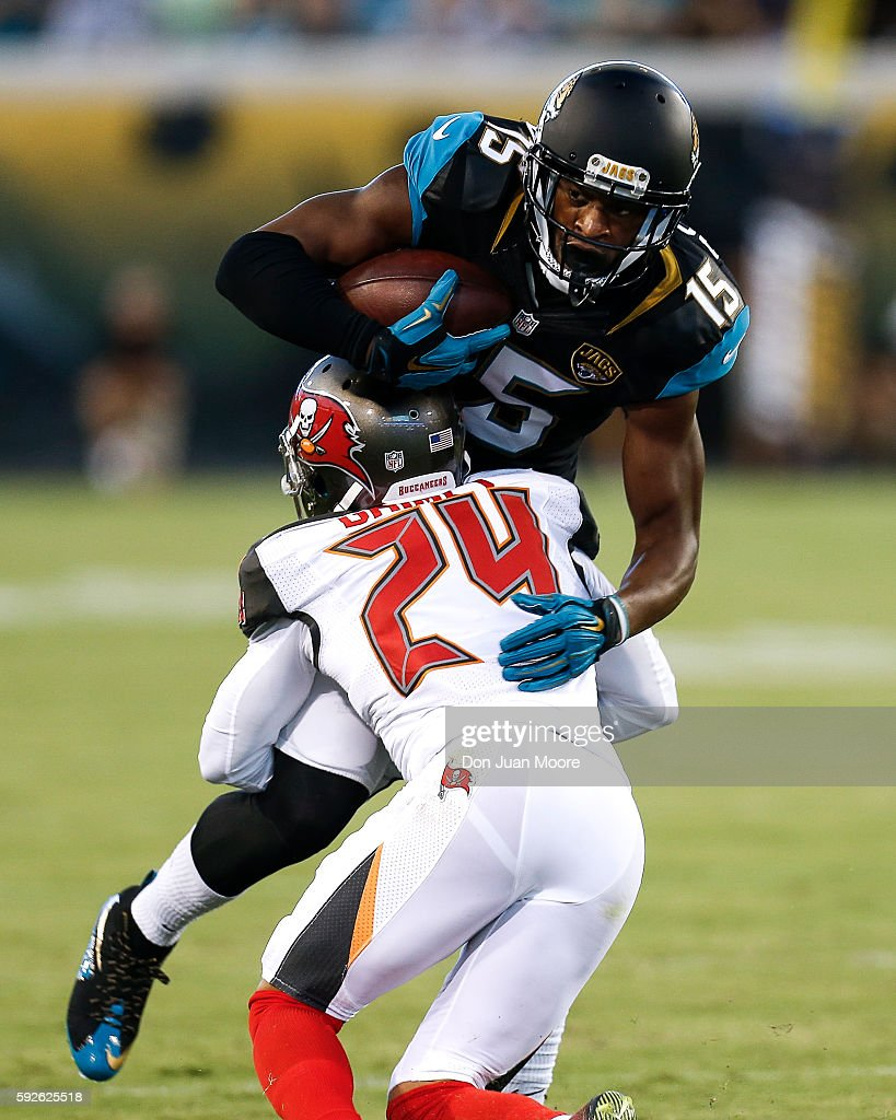 Wide Receiver Allen Robinson #15 of the Jacksonville Jaguars is tackled for a loss by Cornerback Brent Grimes #24 of the Tampa Bay Buccaneers during a preseason game at EverBank Field on August 20, 2016 in Jacksonville, Florida. The Bucs defeated the Jags 27 to 21.
