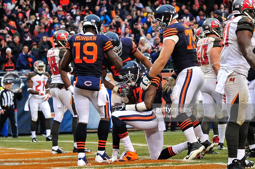 Wide receiver Alshon Jeffery #17 of the Chicago Bears is surrounded by teammates after scoring in the third quarter against the Tampa Bay Buccaneers at Soldier Field on November 23, 2014 in Chicago, Illinois.