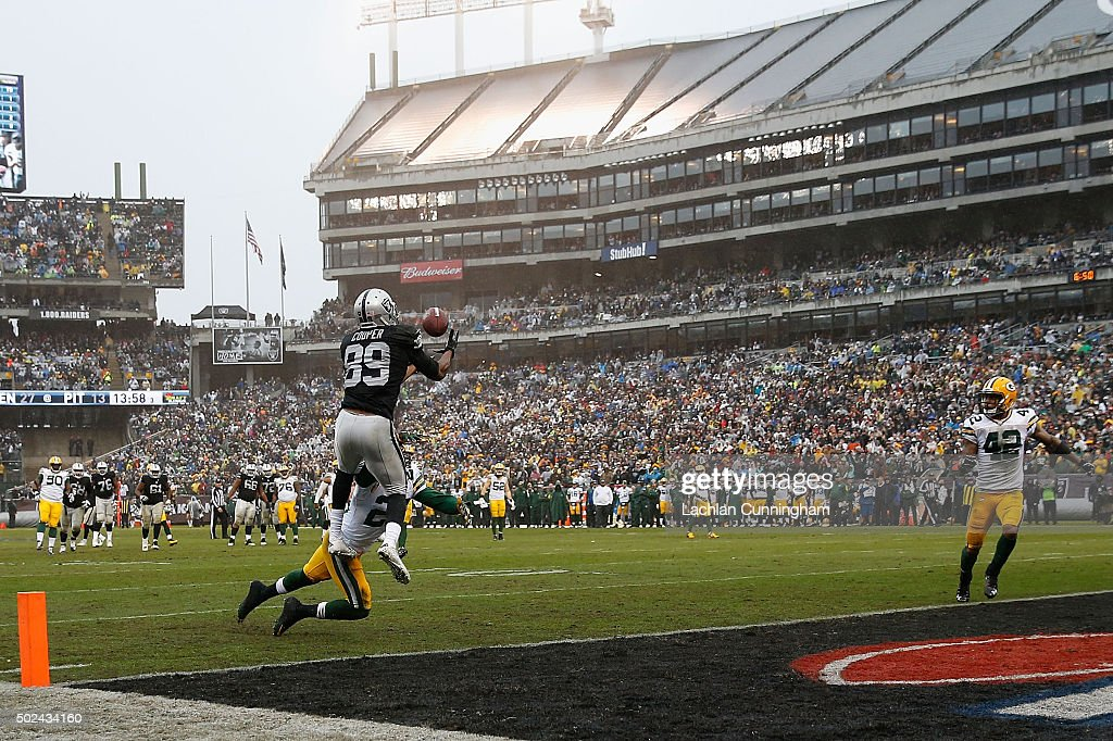 Wide receiver Amari Cooper #89 of the Oakland Raiders catches a touchdown pass against cornerback Damarious Randall #23 of the Green Bay Packers in the third quarter at O.co Coliseum on December 20, 2015 in Oakland, California.