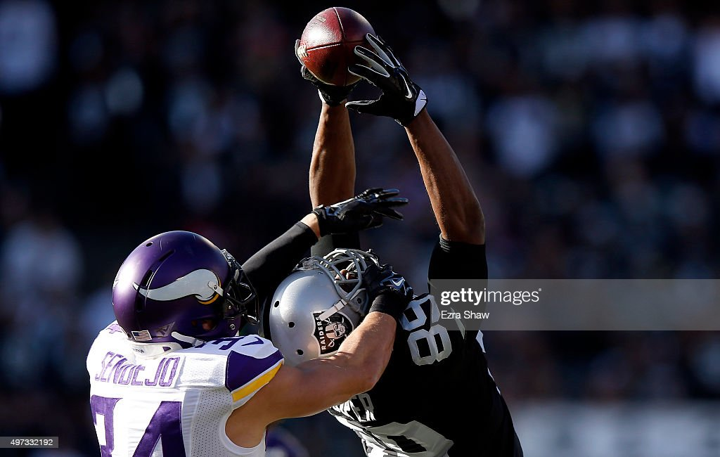 Wide receiver Amari Cooper #89 of the Oakland Raiders makes the reception against strong safety Andrew Sendejo #34 of the Minnesota Vikings in the second quarter at O.co Coliseum on November 15, 2015 in Oakland, California.