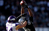 Wide receiver Amari Cooper of the Oakland Raiders makes the reception against strong safety Andrew Sendejo of the Minnesota Vikings in the second...
