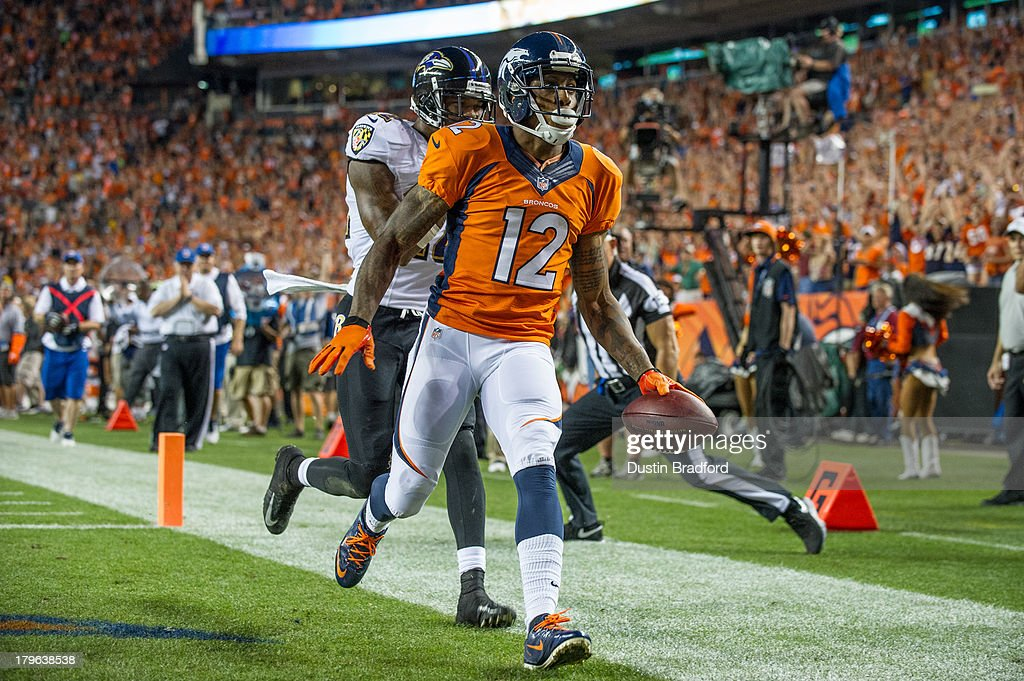 Wide receiver <a gi-track='captionPersonalityLinkClicked' href=/galleries/search?phrase=Andre+Caldwell&family=editorial&specificpeople=2246854 ng-click='$event.stopPropagation()'>Andre Caldwell</a> #12 of the Denver Broncos scores a third quarter touchdown under coverage by Baltimore Ravens cornerback Corey Graham #24 during the game at Sports Authority Field at Mile High on September 5, 2013 in Denver Colorado.