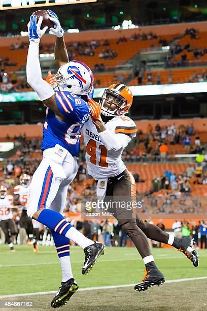 Wide receiver Andre Davis of the Buffalo Bills catches a touchdown pass under pressure from running back Glenn Winston of the Cleveland Browns during...