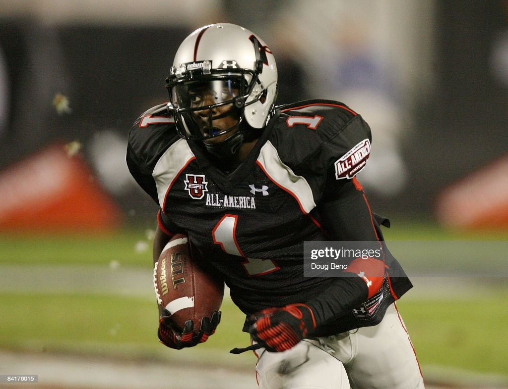 Wide receiver Andre Debose of the black team looks for room to run in the All America Under Armour Football Game at Florida Citrus Bowl on January 4...