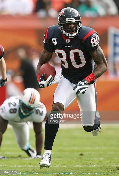 Wide receiver Andre Johnson of the Houston Texans breaks away for a long play while taking on the Miami Dolphins for a touchdown at Land Shark...