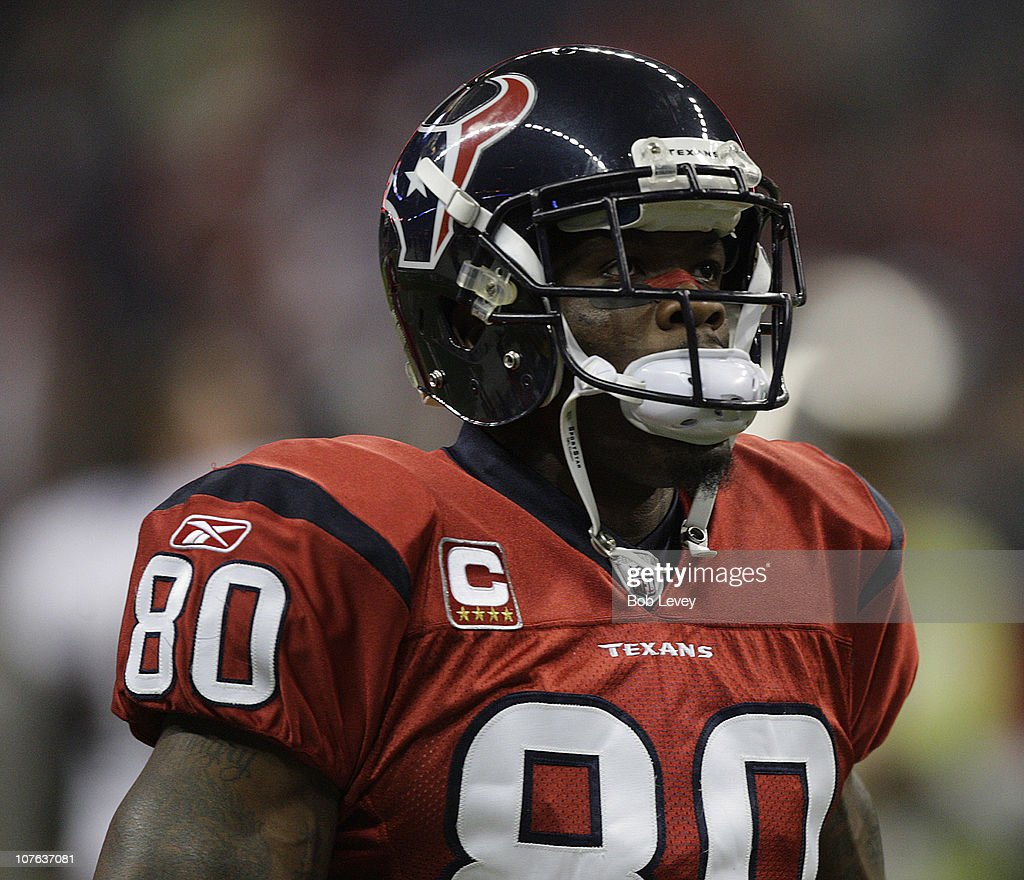 Wide receiver <a gi-track='captionPersonalityLinkClicked' href=/galleries/search?phrase=Andre+Johnson+-+American+Football+Wide+Receiver&family=editorial&specificpeople=12734870 ng-click='$event.stopPropagation()'>Andre Johnson</a> #80 of the Houston Texans during game action against the Baltimore Ravens as he gains a first down late in the fourth quarter at Reliant Stadium on December 13, 2010 in Houston, Texas.